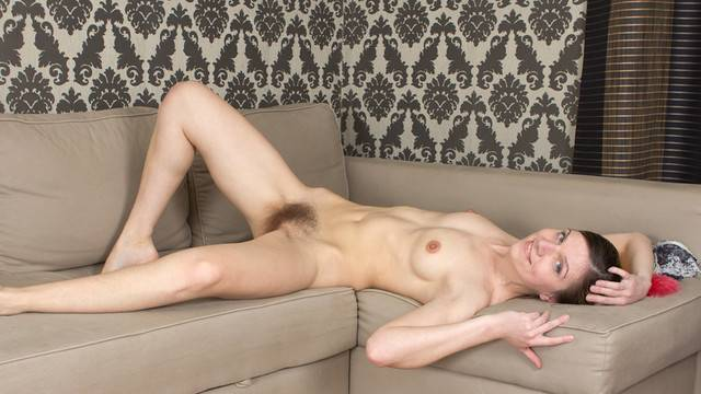British housewife Agatha shows off her hairy pussy on the sofa at Anilos