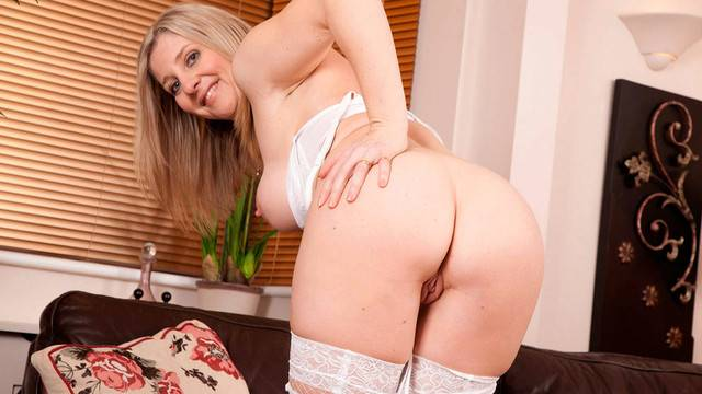 Blonde Tonya plays with her warm moist pussy at Anilos