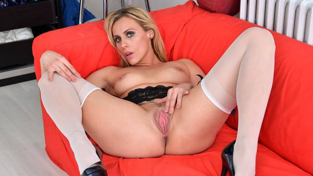 Blonde MILF Brittany Bardot poses on the front of camera at Anilos