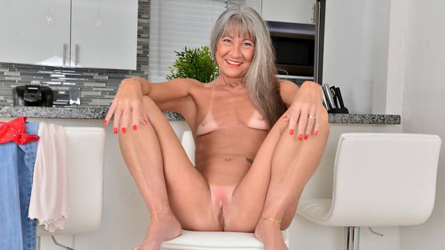 Older mature granny Leilani Lei shows off her small tits at Anilos