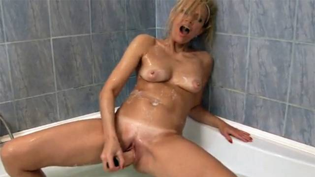 Blue eyed Olga fucks herself in the shower with a sex toy at Anilos