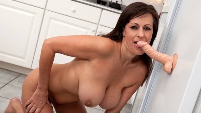Sexy MILF Tori Dean masturbating with her toy in the kitchen at Anilos