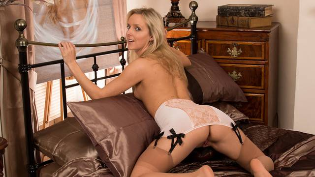 Beautiful MILF Skye Taylor with sexy lingerie playing with her shaved pussy at Anilos