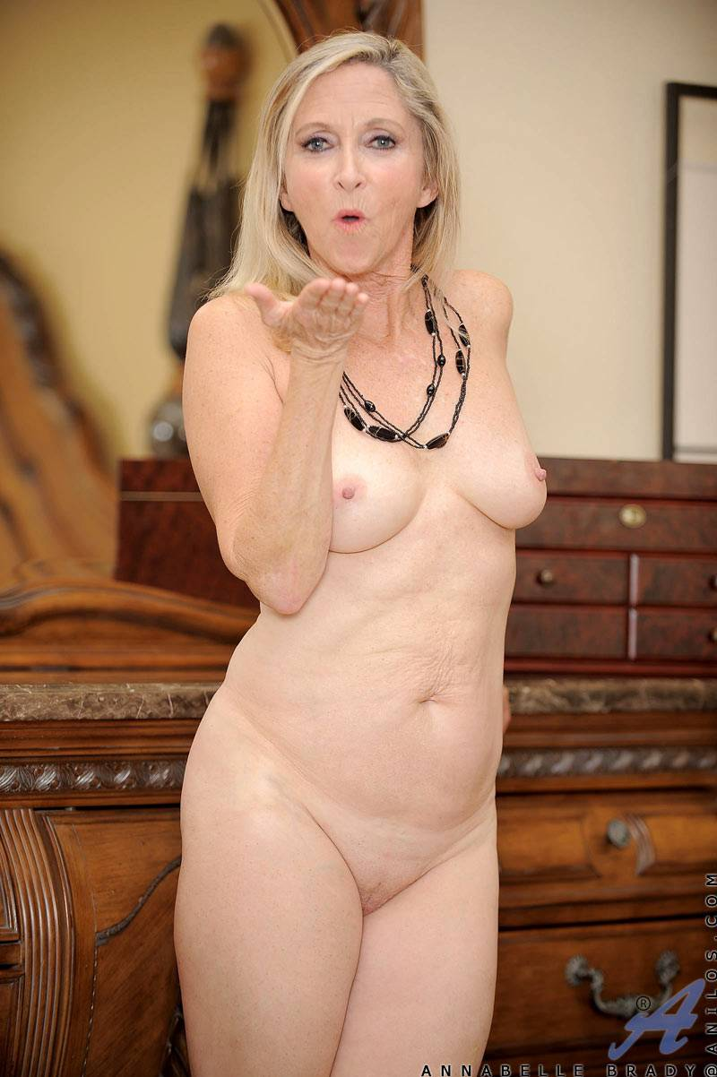 Sexy blonde granny Annabelle Brady fingers her moist mature snatch at Anilos