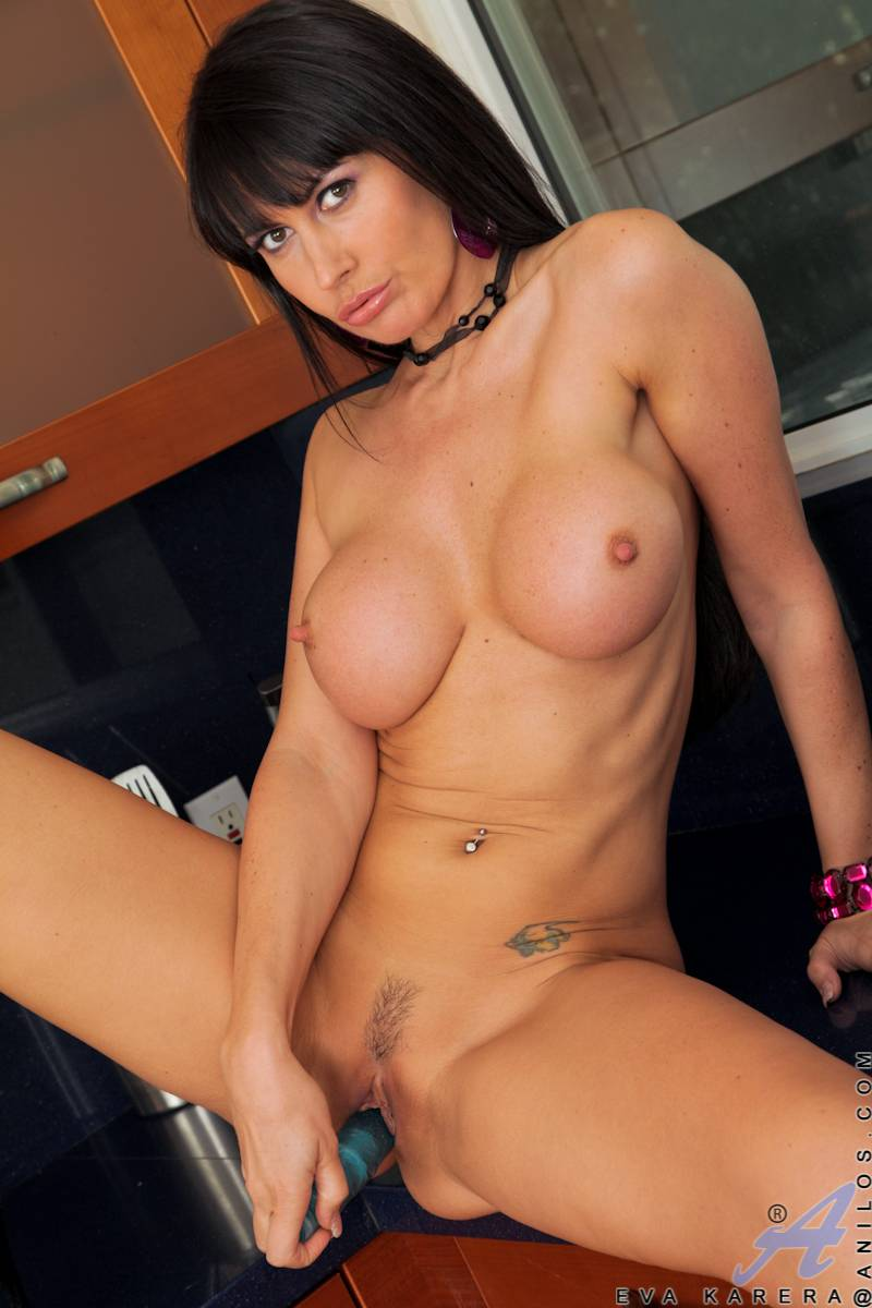 Black haired housewife Eva Karera shows off her striking body in a bra and panties at Anilos