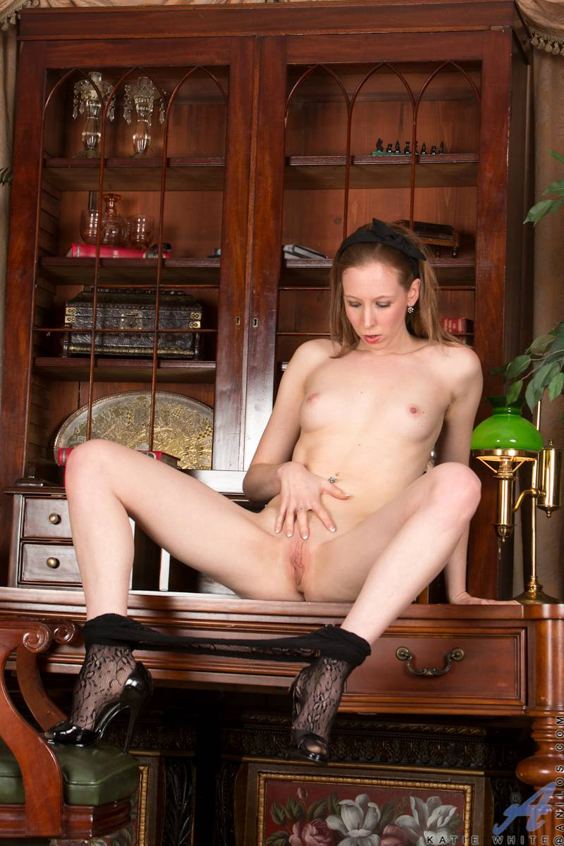 Sexy British housewife Katie White playing with her shaved pussy at Anilos