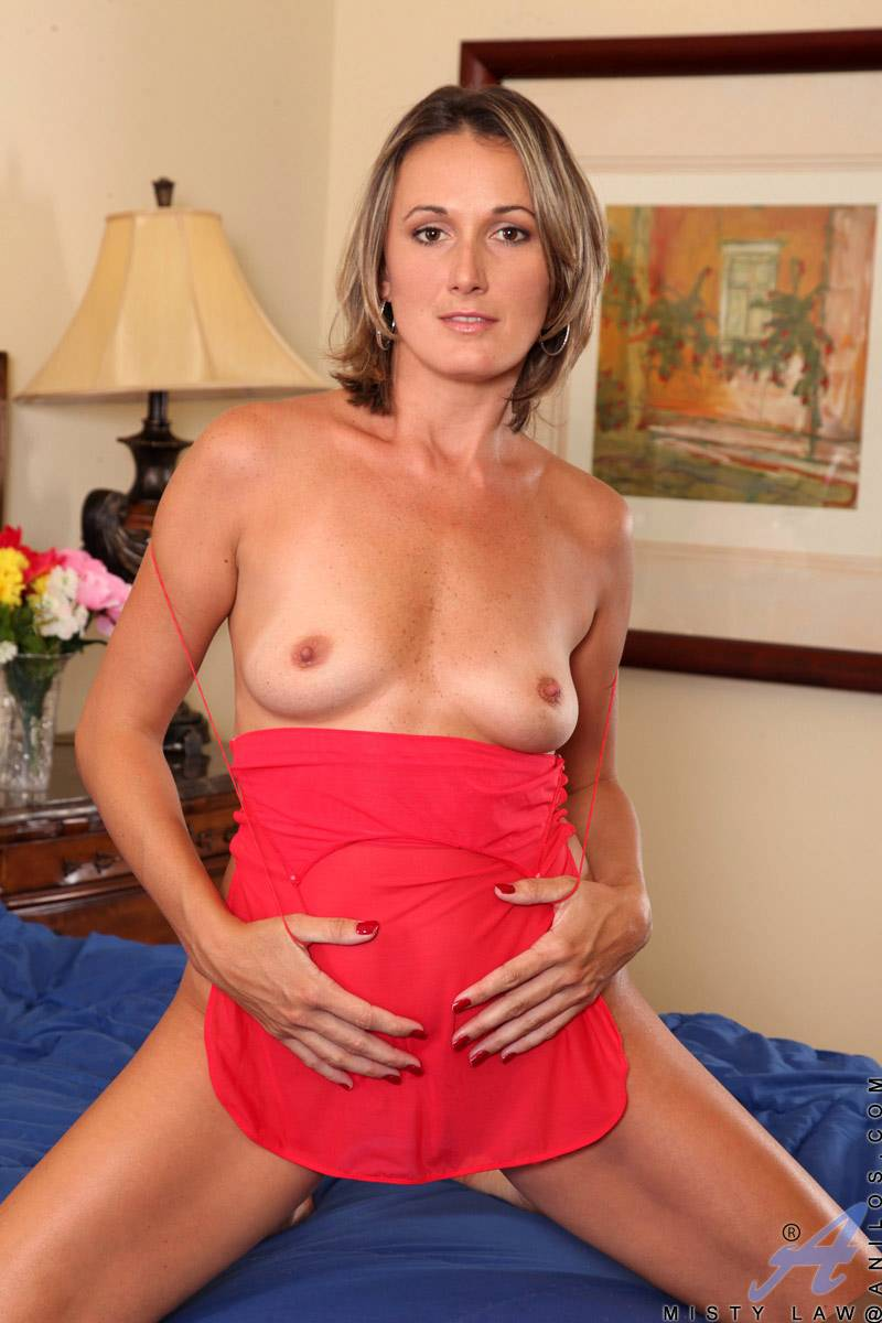 Sexy housewife Misty Law shows off her tight body in a sheer nightie at Anilos