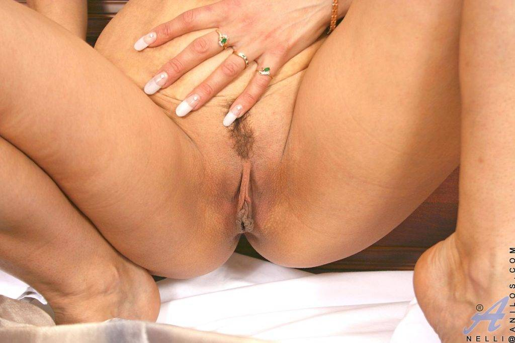 Hot Mature Cougar Nelli Slips Out Of Her Lingerie On The Bed At Anilos