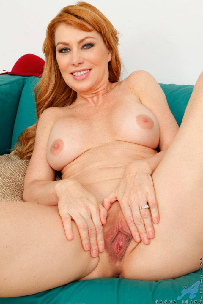 Redhead Milf Sasha Sean Shows Off Her Naked Body On The Sofa At Anilos