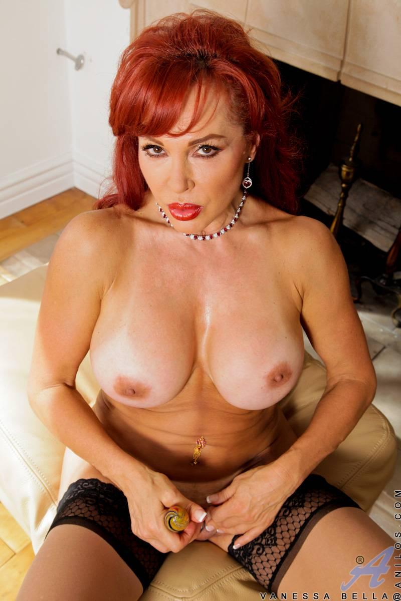 Redhead mature Vanessa Bella masturbate with a lingerie at Anilos