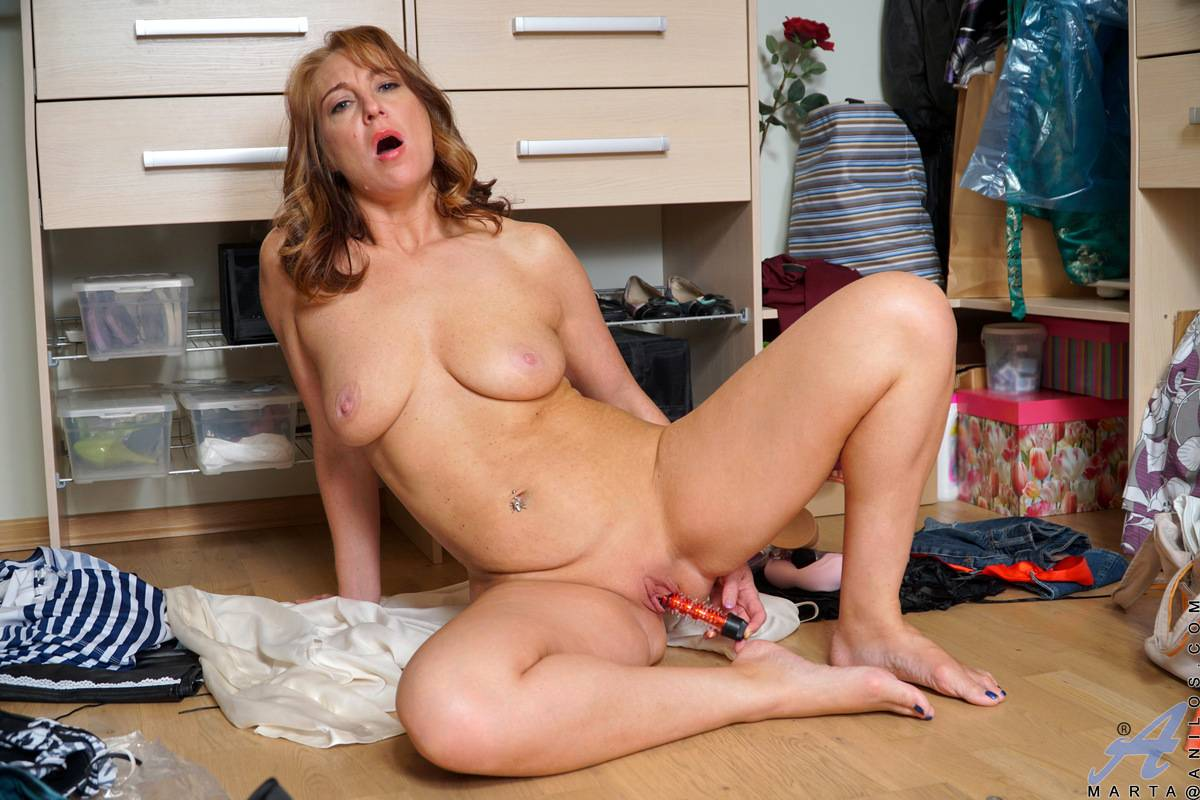 Hot MILF Marta shows off her shaved pussy at Anilos