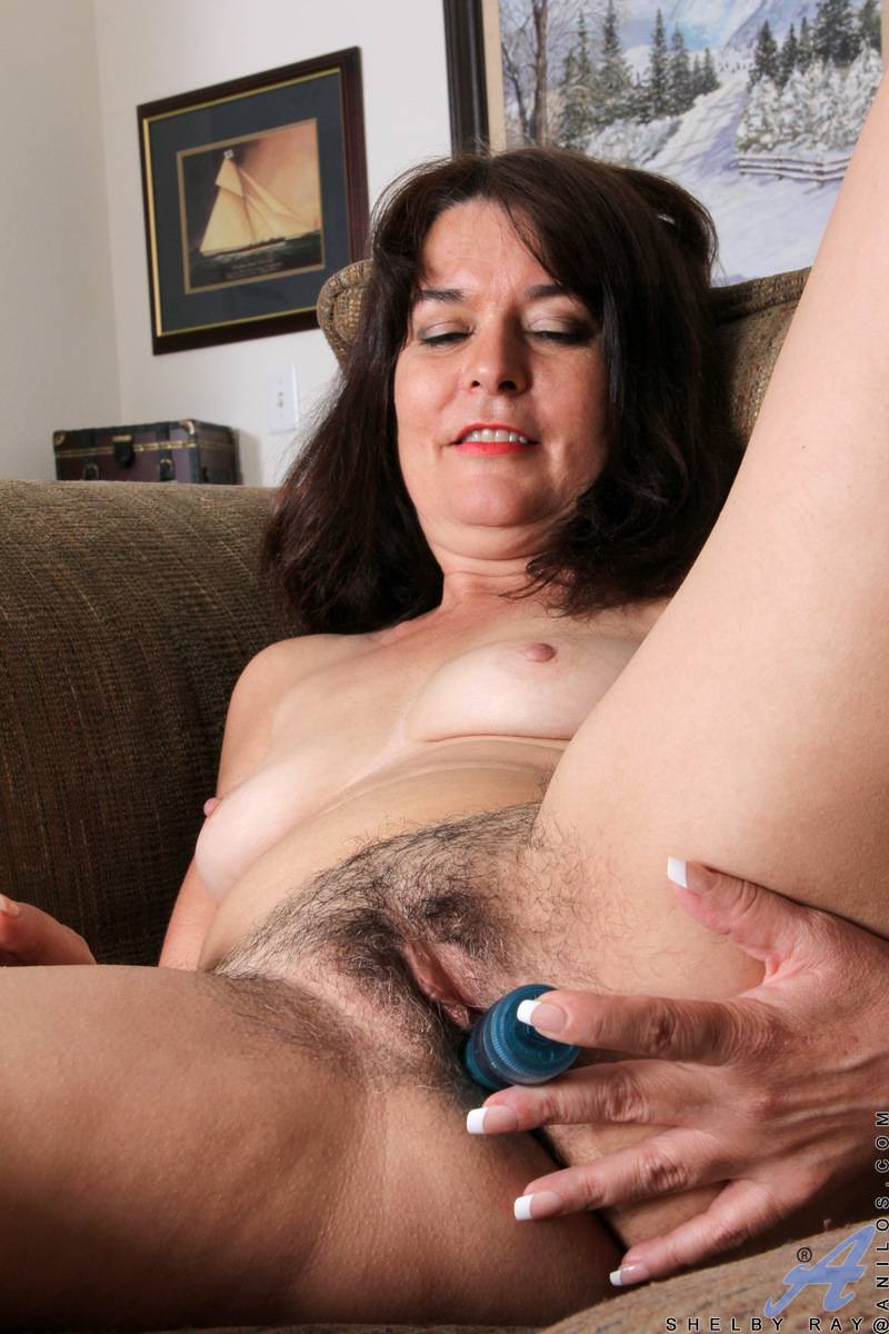 Brunette mature Shelby Ray shows off her unshaved pussy at Anilos