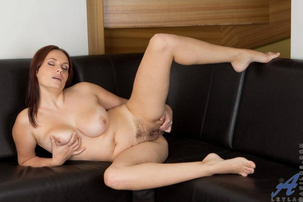 Busty Brunette Housewife Leyla Shows Off Her Shaved Pussy At Anilos