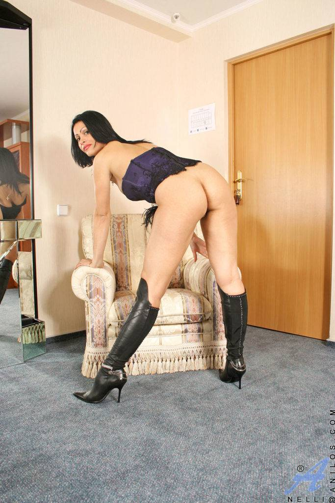 Exotic Milf Nelli Playing With Herself At Anilos