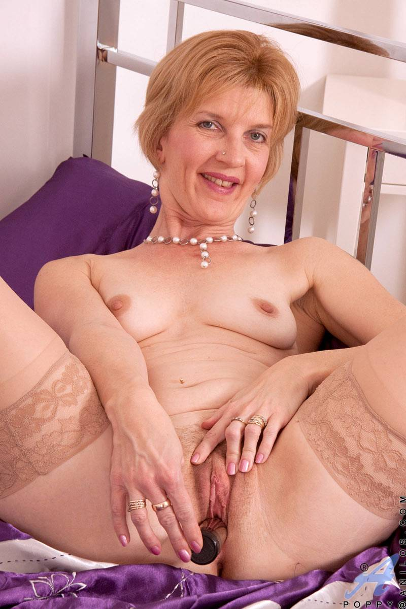 Blonde granny unzips her skin tight dress at Anilos