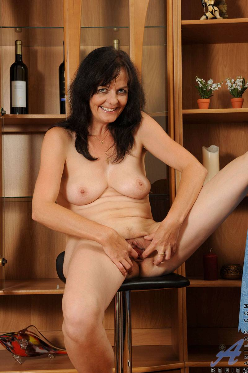 Brunette MILF playing with her shaved pussy at Anilos