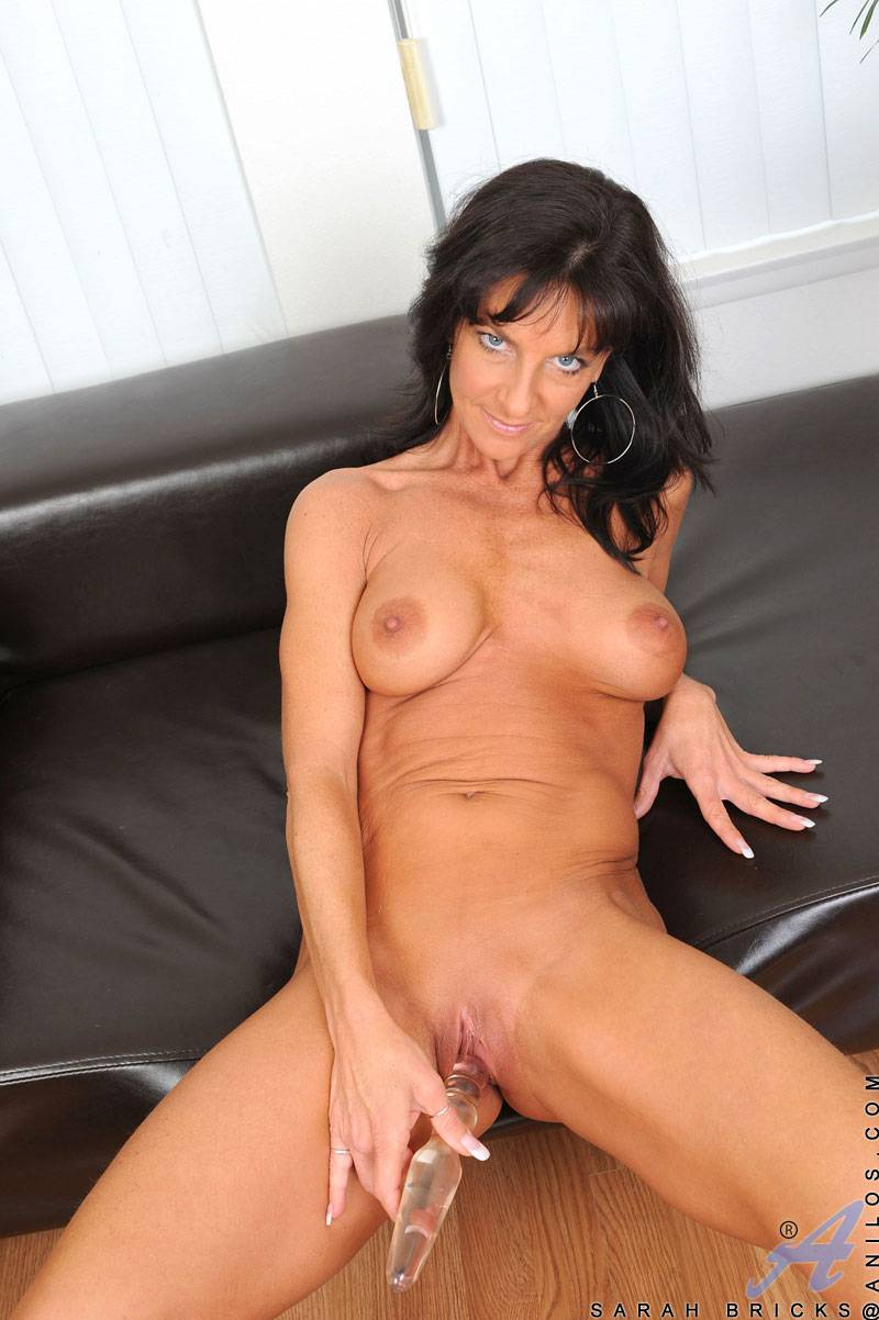 Brunette mature Sarah Bricks playing with her shaved pussy at Anilos
