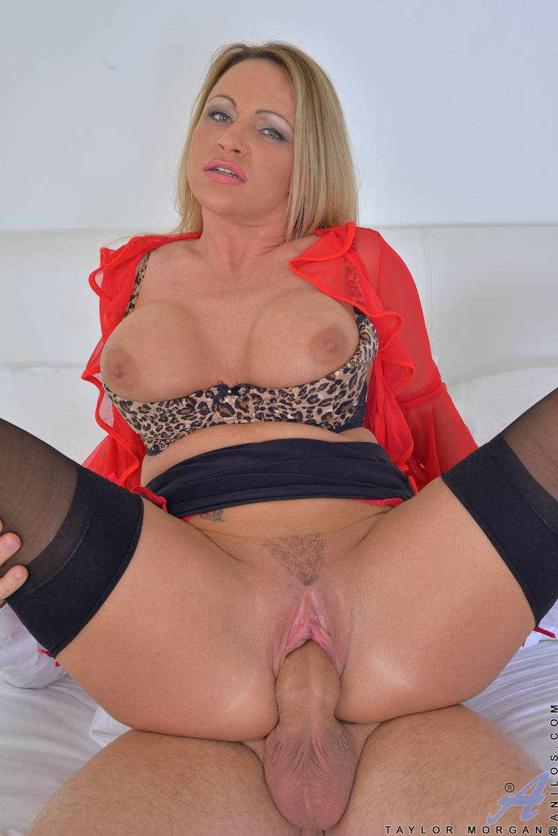 Blonde MILF Taylor Morgan is surprised by her current fuck toy at Anilos