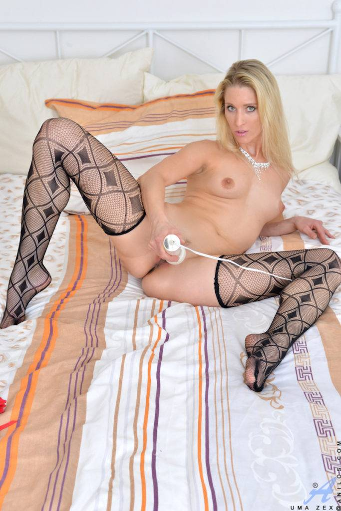 Blonde Milf Uma Zex Strips Off Her Miniskirt On The Bed At Anilos