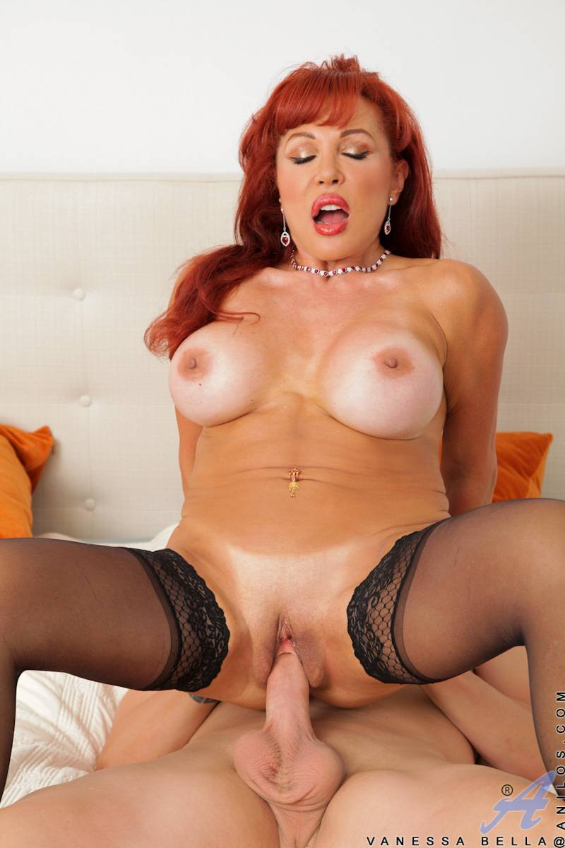Redhead cougar Vanessa Bella playing with her toy boy at Anilos