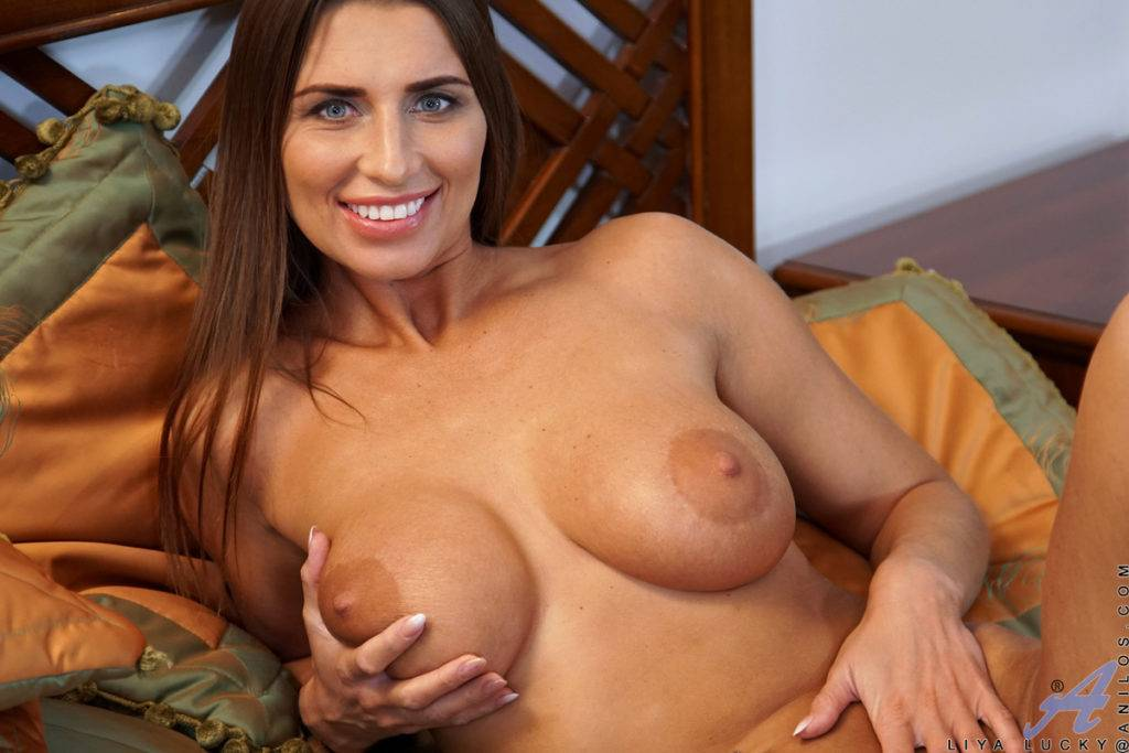 Busty Babe Liya Lucky Shows Off Her Pink Pussy At Anilos