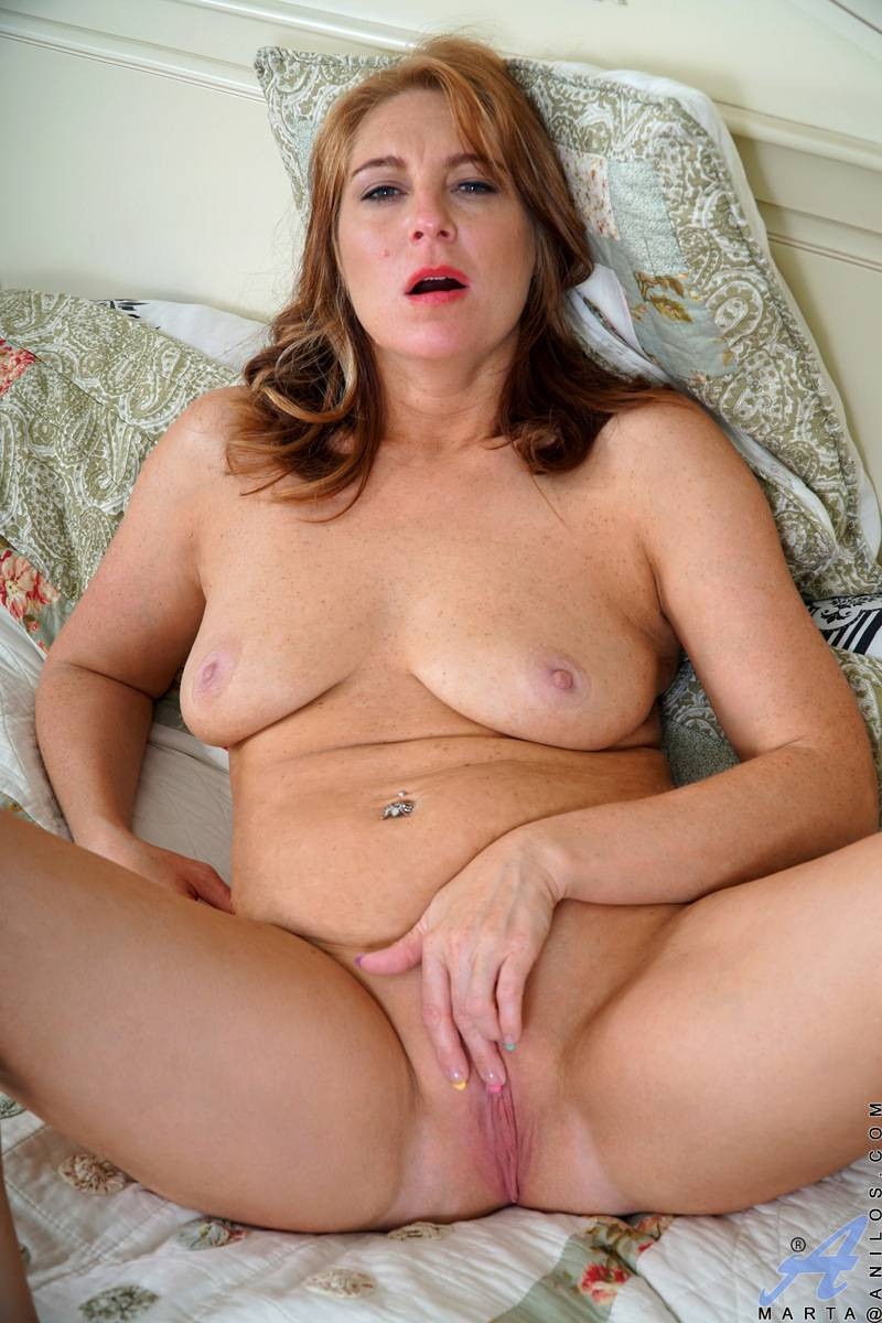 Big tits Russian mom Marta playing with herself at Anilos