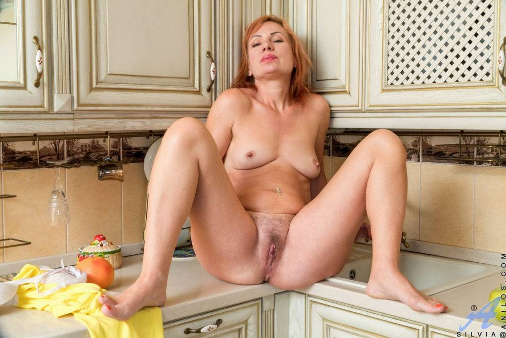 Redhead Mature Silvia Playing With Herself In The Kitchen At Anilos