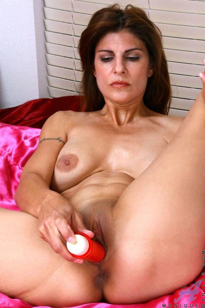 Horny Mature Monique Playing A Dildo Into Her Shaved Mature Pussy At Anilos