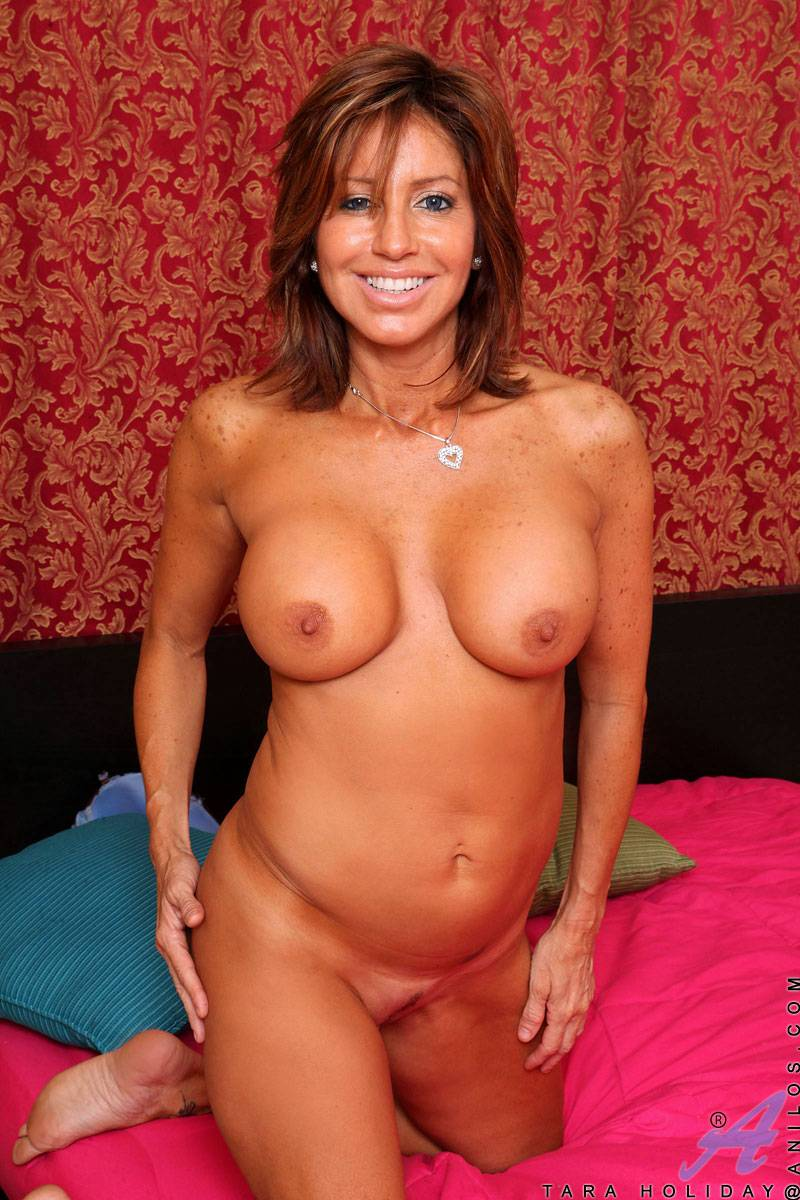 Busty brunette cougar Tara Holiday in sexy lingerie at Anilos